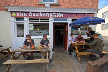 Drinkers enjoying the award winning atmosphere at The Orchard in Bristol